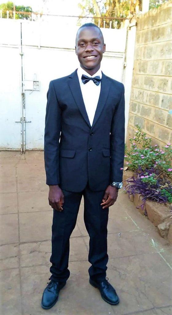 Simiyu in suit